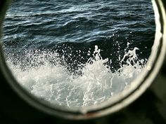 Crashing waves through a porthole via newenglandsocialite