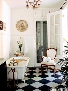 "NEW ORLEANS BATHROOM:  ""Double French doors in a French-style New Orleans cottage's master bath designed by Karyl Pierce Paxton open to the courtyard, screened by a ten-foot cedar fence. The sink base is an 18th-century French buffet with Kohler fixtures.""  housebeautiful.com"