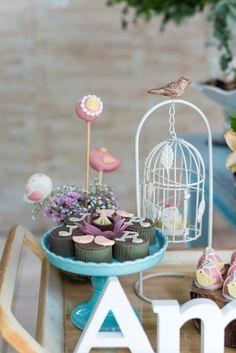 secret garden theme party wood wedding flowers flower arrangement sweet treats cake pops bird cage