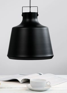 Ceiling lights are ideal for breaking up spaces in open plan living. Get the loft look with this cowbell inspired pendant shade over your breakfast bar. £39 | MADE.COM
