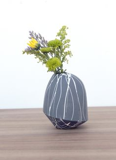 Bean and Bailey Ceramics' splatter birdie vase.   Learn more about all of the working potters featured in the June/July/August 2015 issue of Ceramics Monthly here: http://ceramicartsdaily.org/ceramics-monthly/ceramics-monthly-junejulyaugust-2015/