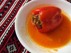 Romanian stuffed red bell peppers... My romanian friend made these while I visited her in her home in Sicily. This is a wonderful warm dish on a cold winter day. My romanian friend said they would eat these often on the coldest winter days. Delicious!