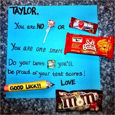 "Test encouragement to my daughter. You are no ""Dum Dum"" or ""Airhead."" You are one smart ""Cookie."" Do your best ""Now & Later"" you'll be proud of your test scores! Love, ""Mom"" The pencil is a roll of ""Mentos"" wrapped in colored scrapbook paper. The pencil lead is made from aluminum foil and the tip was colored with a black sharpie."