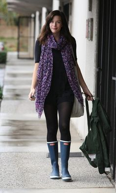 Liv Tyler in purple animal print sheer scarf and rain boots.