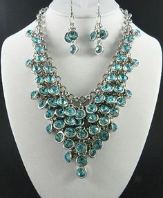 """Gorgeous!  Rhodium ( 14k white gold eg ) statement necklace 18"""" with lobster clasp is adjustable to 22"""".  Aqua crystals ( .5"""" diameter) are bezel set. Tiered chainmail drop of 3.5""""  Very, very nice quality. Sorry, earrings shown in photo are sold out, and not included."""