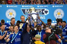 Leicester captain Wes Morgan and manager Claudio Ranieri crown a day they'll never forget by lifting the Premier League trophy