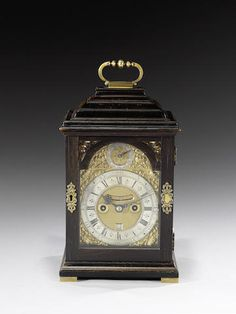 A fine early 18th century ebonised table clock of small size Simon de Charmes, London