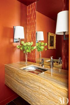 The powder room in a Manhattan apartment by designer Bruce Bierman features a vanity made of Macaubas Gold quartzite.