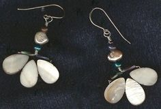 Grey Mother of Pearl and Iridescent Freshwater Pearls make up these Subtle Fleur De Lis earrings. Hooks -  Sterling Silver