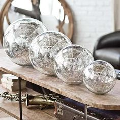 fabulous! DIY- fish bowls of different sizes sprayed with mirror looking glass