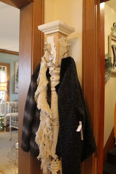 Salvaged post turned into coat rack - great idea for the extra coat storage needed around the holidays.