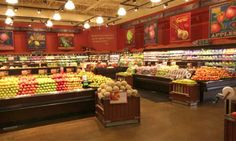 Love the rich color on the walls, along with the artwork. Makes the produce even more appetizing.