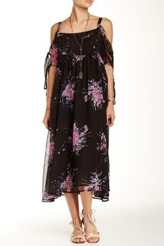 Fluttery short sleeves complement the breezy silhouette of a floral midi-dress.