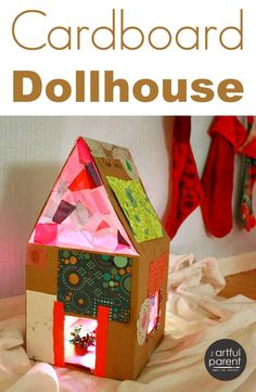 How to make your own beautiful cardboard dollhouse with kids. This one has stained glass windows (easy!) and rainbow lights. A great craft + gift!