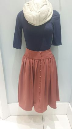 Knitted scarf $16.99, 3/4 sleeve jersey top $9.99, Mikarose Cute as a Button skirt $44.99.