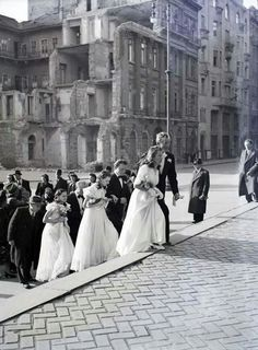 1946. Wedding(s) at the St Stephen's Basilica, ruined buildings in the background