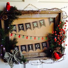 Christmas wreath made from old barn wood picture frame with battery powered led lights
