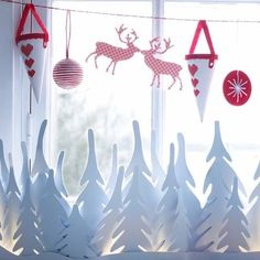 IKEA Christmas trees light decoration, could make a similar christmas tree forest with fairy lights
