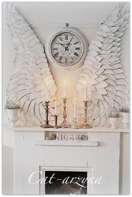 clock with wings mantel or above headboard