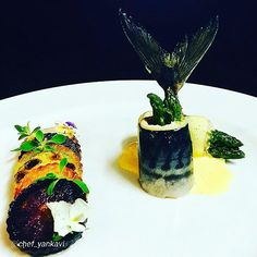 "By @chef_yankavi ""Bearnaise sauce, green asparagus pouch filled with mackerel, grilled purple carrots, potatoes, pumpkin green pumpkin majaro the."""