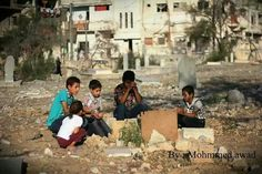 Children visiting the grave of their little friend who was killed in the recent bombardment of Gaza. October 2014.