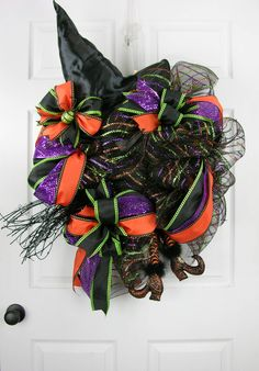 Lots of ribbon loops with a witch hat, broom and legs in this Halloween design…