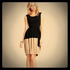 Ann Taylor Color Block Tulip Dress The 'Color Block Tulip Dress' by Ann Taylor is modern, ensures elegance, and has a classic simplicity. The jersey knit black and camel toned ensemble has a wide bateau neckline, black tie belt at the waist, and a gathered bubble skirt that is cinched at the hemline. Ann Taylor Dresses