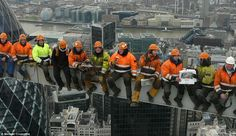 The photo - modelled on Charles C Ebbets's famous 1932 original, Lunch atop a Skyscraper - was taken by Michael Crompton, as he worked on Heron Tower in central London last year. Famous Photos, Old Photos, East London, London City, Steel Erectors, Lunch Atop A Skyscraper, London Boroughs, Hard Hats, Pulsar