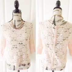 """H&M Light Pink Lace Cropped Top This top has a light pink Floral lace fabric with quarter inch sleeves and a slightly cropped hemline. The back is lined with buttons. {actual color of item may vary slightly from pics}  *shoulders:16"""" *chest:17.5"""" *waist:17.5"""" *length:19.5""""/sleeves:15.5"""" *material/care:tag cut/lace no stretch hand wash  *fit:tag says 10 fits like medium  *condition:light wear/no rips/stains  🌸20% off bundles of 3/more items 🌸No Trades  🌸NO HOLDS 🌸No transactions outside…"""