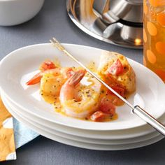 Tomato Cheddar Fondue Recipe -In addition to shrimp, I serve this cheesy fondue with French bread cubes. Every bite tastes like a little gourmet grilled cheese sandwich. —Roberta Rotelle, Honey Brook, Pennsylvania