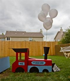 The Red Webs: Will's 2nd Birthday DIY Choo Choo Extravaganza. I love the cluster of helium balloons as a smoke and the train tracks on the walk way.