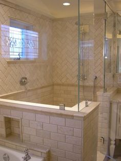 Neutral bathroom. Layout would work great in a small bath or a larger one.  Love anything herringbone.  MasterBath shower??