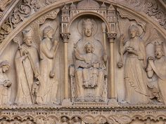 Detail of the tympanum of the portal of St. Anne on Notre Dame Cathedral