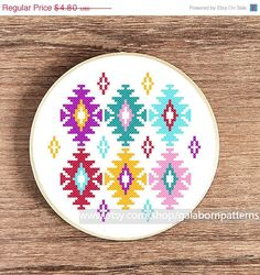 Tittle: Ikat    This PDF counted cross stitch pattern available for instant download.    Skill level: Beginner.    Floss: DMC    Fabric: