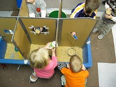 Cardboard dividers for sensory table. Wish I thought about this when I was teaching!