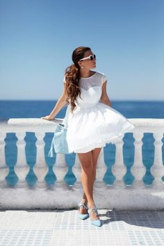 What to Wear With a Little White Dress - flowing white high neck dress with cap sleeves, styled with blue suede low heels