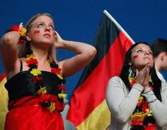 Adorable World Cup German stripes flag tattoo on fans' face