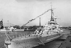 Fine early view of 11 in battleship Scharnhorst at Kiel before the 1939 modifications which shifted her mainmast further aft. She operated to considerable effect in the early years of WW2, generally in conjunction sister Gneisenau till the latter's irrepairable damage at the hands of the RAF in February 1942. Scharnhorst was sunk at the Battle of the North Cape on Boxing Day 1943.