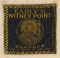 Early's Witney Point blanket label showing the Native American symbol they adopted for their point blankets.