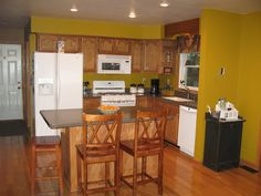 Image result for kitchen with mustard walls