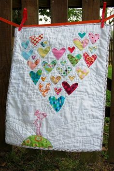 Heart quilt from old baby clothes.... oh my....love this idea.  Would be fun with circles as bubbles, or a tree with blowing leaves, too.