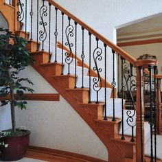 Wooden rails with stylized cast iron banisters.