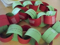 Making paper chain garlands from construction paper to decorate the classroom (elementary school).