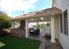 Outdoor, covered patio for kitchen.