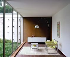 Wassily Chairs and the Laccio Table, designed by Marcel Breuer.