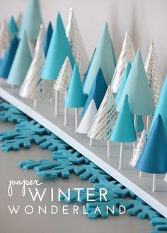 Looking to make your mantel extra festive this holiday season? Try this easy to make DIY Winter Wonderland Decor made from paper!