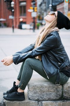 All black everything featuring high top monochrome converse folded down
