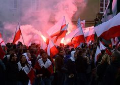 In Poland-right-wing-demonstrators-hold-flags-during-a-protest