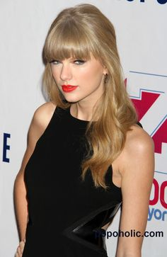 Taylor Swift  As a light spring, the black and overly harsh red lipstick are too strong for her.