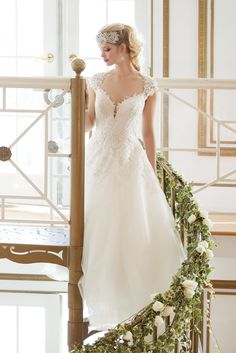 There's nothing more romantic than a lace ball gown with cap sleeves.